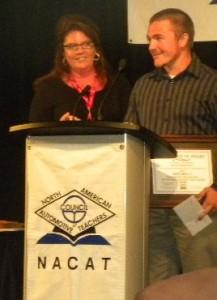 Shane receiving award from Karen Wagner, Sr. Marketing Mgr. Mitchell 1.